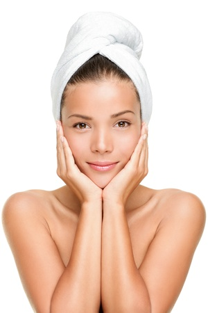 Foto de Spa skin care beauty woman wearing hair towel after beauty treatment. Beautiful multiracial young woman with perfect skin isolated on white background. Mixed race Caucasian / Asian female beauty model looking at camera. - Imagen libre de derechos