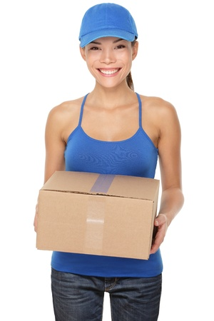 Delivery postal service woman holding and delivering package wearing blue cap. Woman courier smiling happy isolated on white background. Beautiful young mixed race Caucasian / Chinese Asian female professional.