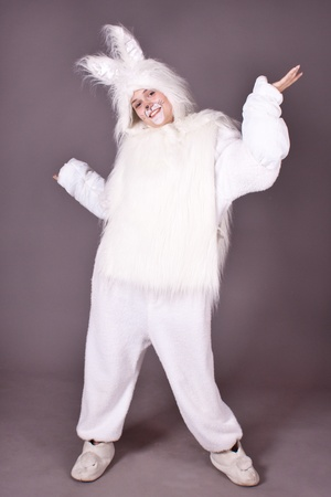 A girl in a white suit, hare, rabbit. White background. Studio photography.