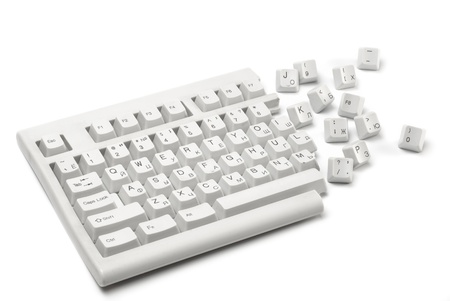 One half of a broken keyboard with keys near isolated on white