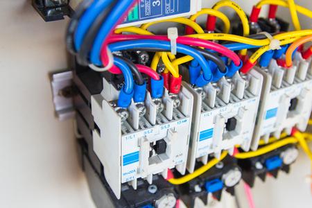 Photo pour Close up circuit breakers and wire in control panel - image libre de droit