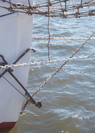Photo for closeup of the prow of a big sailing yacht, with chains and anchor - Royalty Free Image