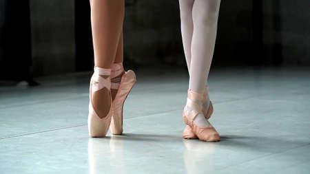Photo pour A close up on a ballerina feet during a ballet with focus - image libre de droit