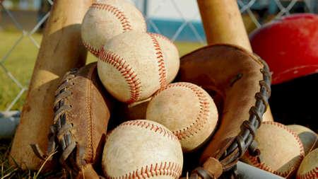 Photo pour A close up on balls, a glove and bats of baseball - image libre de droit