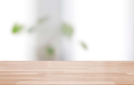 Photo pour Empty wooden table and blurred modern indoor white kitchen coffee cafe background, restaurants. Ready for product montage display. template - image libre de droit