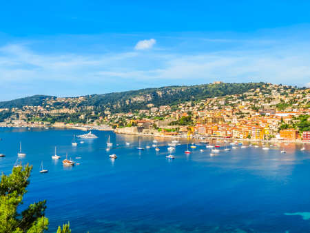 Photo pour Fishing boats and yachts in the Villefranche-sur-Mer bay. Landscape of the Cote d'Azur, Villefranche-sur-Mer, France - image libre de droit
