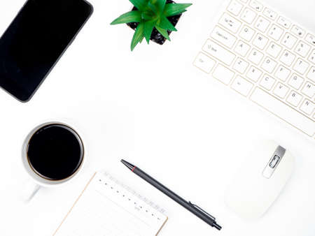 Photo for Modern white office desk table with keyboard computer, coffee, smart phone and other office supplies of necessity, Top view with copy space - Royalty Free Image