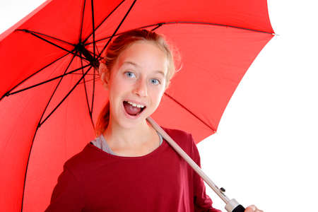 laughing blond girl with red umbrella in frontof white background