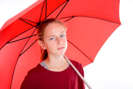 blond girl with red umbrella in frontof white background