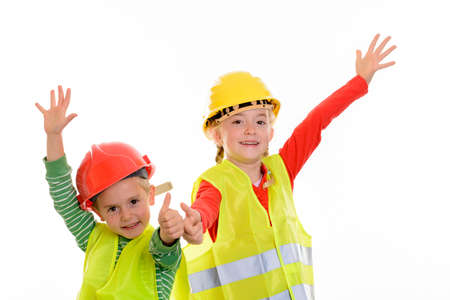 boy and girl with reflective vest and helmet in front of white background