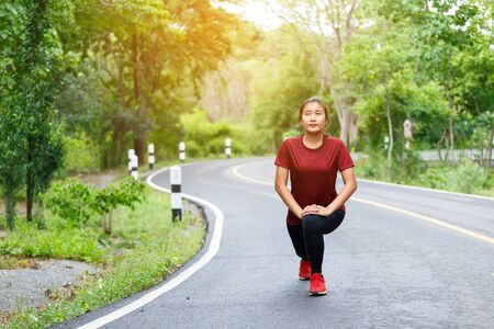 Photo for Woman runner's stretching her legs muscles before running. - Royalty Free Image