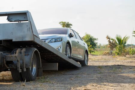 Photo for Tow car service on side for loading broken car to the garage. - Royalty Free Image