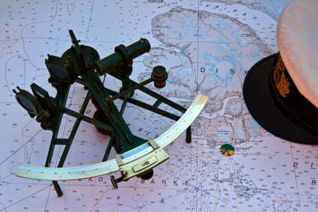 Photo pour Old sextant on a nautical chart from the northern part of Greenland - image libre de droit