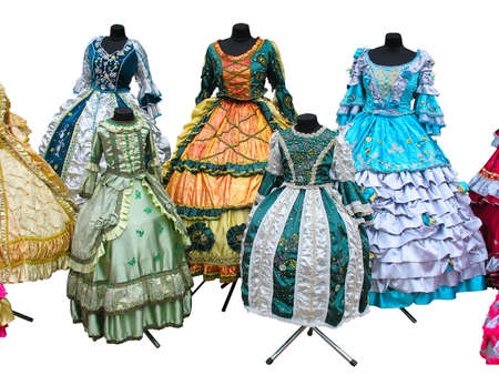 Colorfull stylized woman medieval costume clothes on mannequins isolated