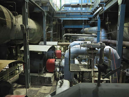 Photo pour Industrial big water pumps with electric motors, pipes, tubes, equipment and steam turbine at modern power plant - image libre de droit