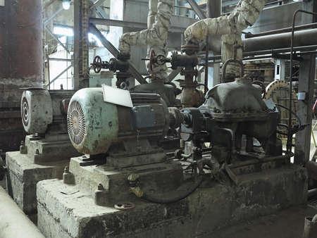 Foto für Industrial big water pumps with electric motors, pipes, tubes, equipment and steam turbine at modern power plant - Lizenzfreies Bild