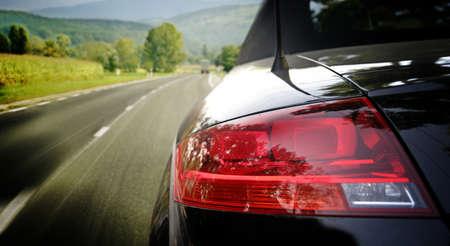 Black car on the highway