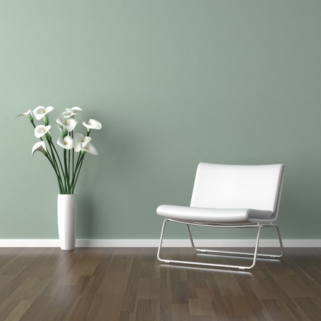 interior design scene with a white modern chair and avase of calla lillys on a pale green wall