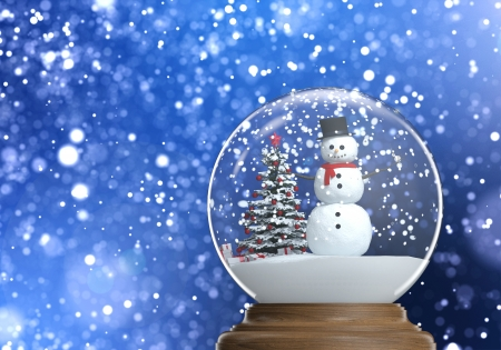snowglobe with snowman and christmas tree inside on a blue snowy defocused background copy space