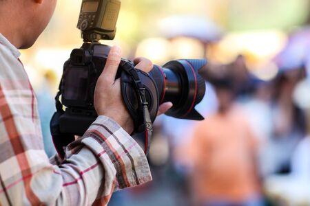 Photo pour Photographer and digital camera. - image libre de droit