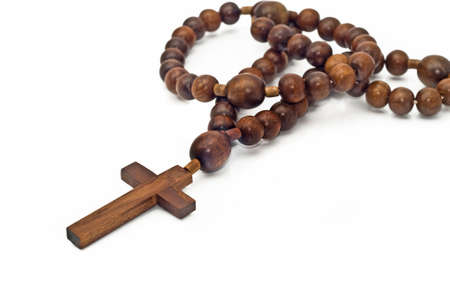 Brown Wooden beads isolated over white with focus on christ (shallow DOF)