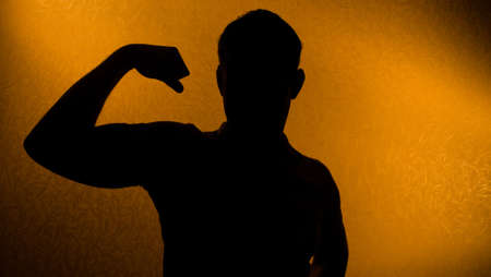 Strength and health - silhouette of man in the darkness