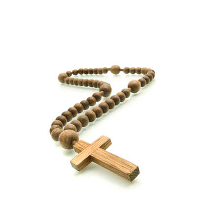 Wooden rosary beads isolated over white