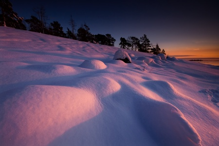 Sunset lighted snowy mounds