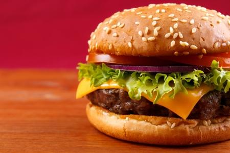 Hamburger closeup on red background