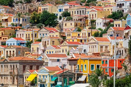 Foto de Traditional greek colorful houses in Symi island. Dodecanese, Greece. - Imagen libre de derechos