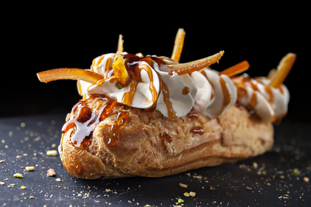 exquisite cream dessert eclair with candied fruit