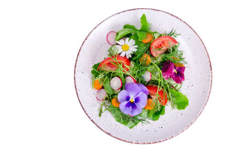 Photo for Vegetable salad with edible flowers on white background - Royalty Free Image