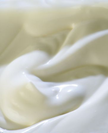 Milky cream waved surface. Close-up.の写真素材