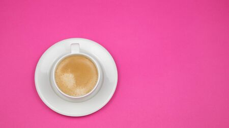 Photo pour A cup of black coffee on pink background. View from above. copy space. - image libre de droit