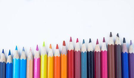 Foto de A close-up of colorful crayons isolated on a white background. - Imagen libre de derechos