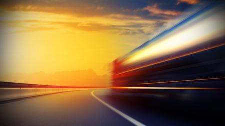 Photo pour 3d illustration of a blurry oil tanker truck on asphalt road under evening sky and sunset light - image libre de droit