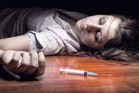 Close-up on the floor of the syringe with the drug  In the