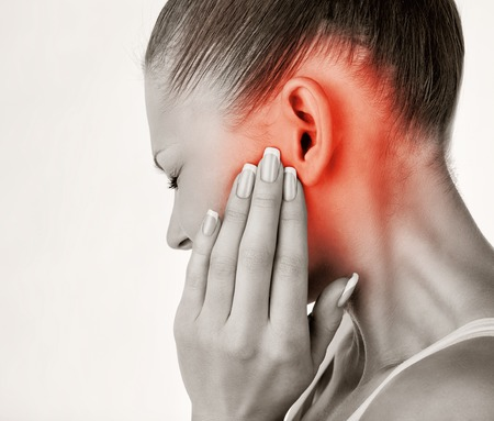 Foto für Young woman with ear pain, holding hand on his head. Isolate on white background - Lizenzfreies Bild