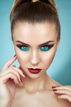 Photo for Art design makeup. Fashion model young woman in trendy make-up looking at the camera. Eye models with colorful glitter on the eyelids - Royalty Free Image
