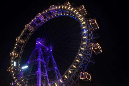 Photo for Ferris Wheel night carnival colorful illumination circle construction shape object - Royalty Free Image