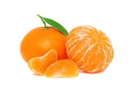 Two ripe mandarins and two slices with green leaves isolated on white background