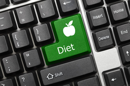 Photo pour Close-up view on conceptual keyboard - Diet (green key with apple symbol) - image libre de droit