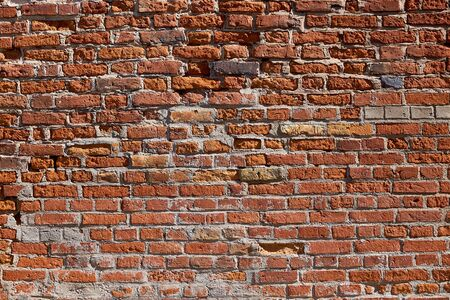 Photo pour Texture of an old brick wall. Old red brick masonry. The brick background. - image libre de droit