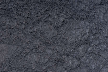 Black self made paper pressed sheet texture background. Embossed lace pattern.