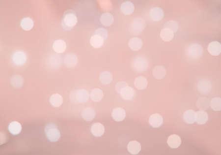 Foto de Bokeh lights defocussed festive background texture toned in trend color Living Coral. - Imagen libre de derechos