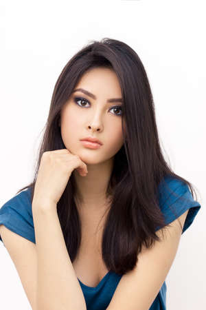 Portrait of beautiful young woman with serious look. Mixed race Asian Chinese White Caucasian female model.