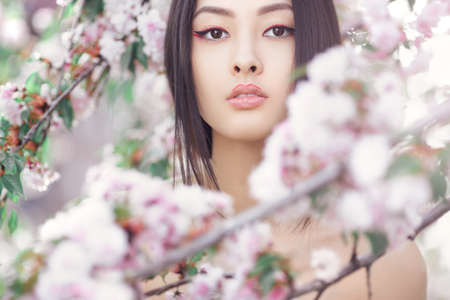 Photo for Perfect model with creative vivid makeup and pink lipstick on lips and traditional japanese hairstyle posing outside. - Royalty Free Image