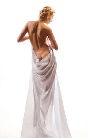 naked beautiful woman in a sheet on a white background