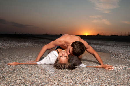 Photo for guy kiss his girlfriend on the beach - Royalty Free Image