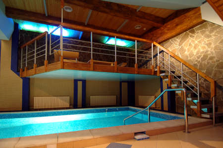 view of screened in swimming pool and lanai with sitting area